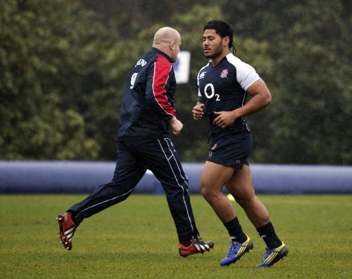 England's prop Dan Cole (L) and England's centre Manu Tuilagi (R) warm up at the team's training base, March 8, 2013