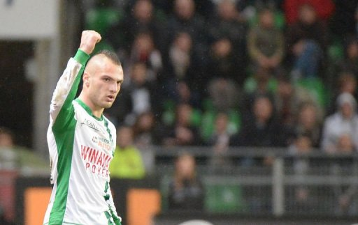 Saint-Etienne's midfielder Yohan Mollo celebrates after scoring on March 8, 2013 in Rennes, western France