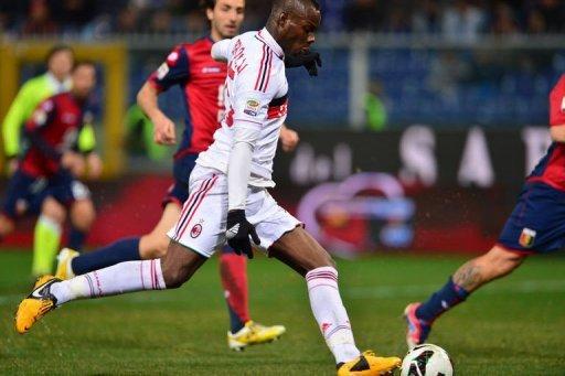 AC Milan's forward Mario Balotelli kicks to scores at the Marazzi Stadium in Genoa on March 8, 2013