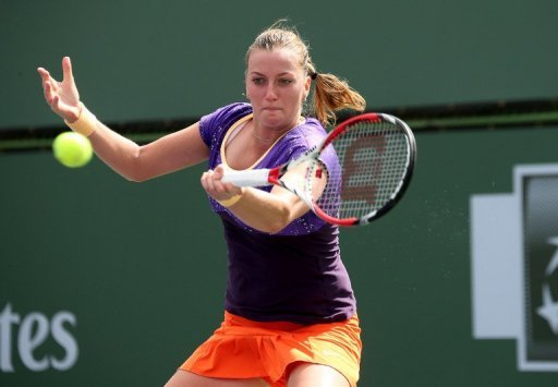 Petra Kvitova of the Czech Republic hits a return to Olga Govortsova of Belarus during on March 8, 2013 in Indian Wells