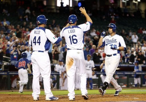 Chris Colabello (R) of Italy is congratulated by Anthony Rizzo and Alex Liddi on March 8, 2013 in Phoenix, Arizona