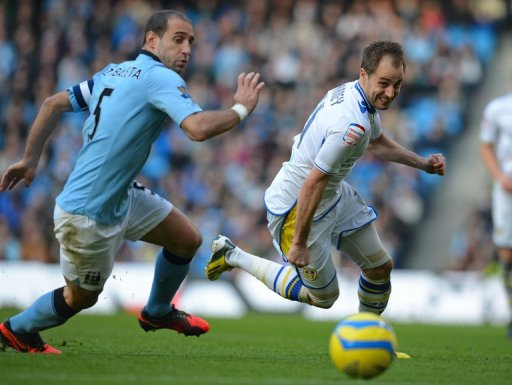 Manchester City defender Pablo Zabaleta (L) chases Leeds United's Luke Varney in the FA Cup on February 17, 2013