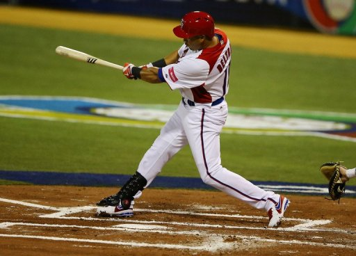Carlos Beltran hits out against Spain in the World Baseball Classic on March 8, 2013