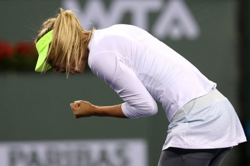 Maria Sharapova celebrates winning a point at the BNP Paribas Open at Indian Wells on March 8, 2013