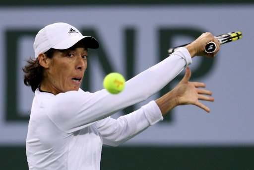 Francesca Schiavone hits a return to Maria Sharapova at the BNP Paribas Open on March 8, 2013