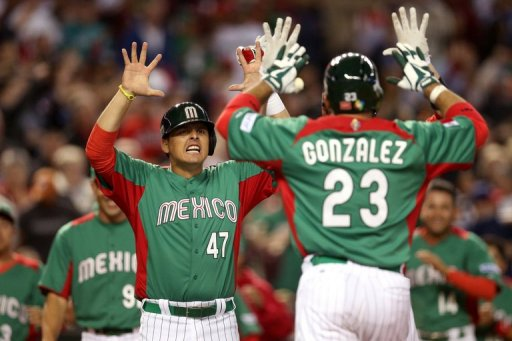 Mexico's Luis Cruz (L) congratulates teammate Adrian Gonzalez, at Chase Field in Phoenix, Arizona, on March 8, 2013
