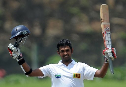 Lahiru Thirimanne raises his bat after scoring a century during the opening Test against Bangladesh on March 9, 2013