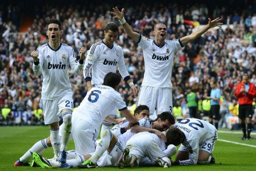 Real Madrid players celebrate their second goal against Barcelona in Madrid on March 2, 2013