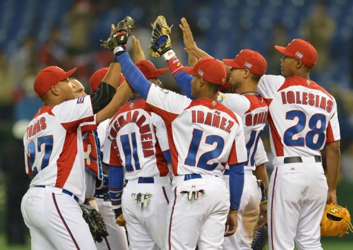 Cuban players celebrate their win over Taiwan in the World Baseball Classic tournament at Tokyo Dome on March 9, 2013