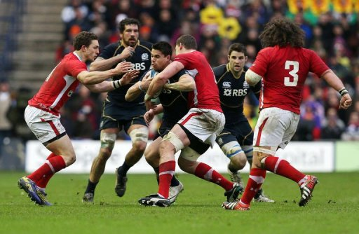 Scotland's Sean Maitland is tackled by Ian Evans in Edinburgh on March 9, 2013