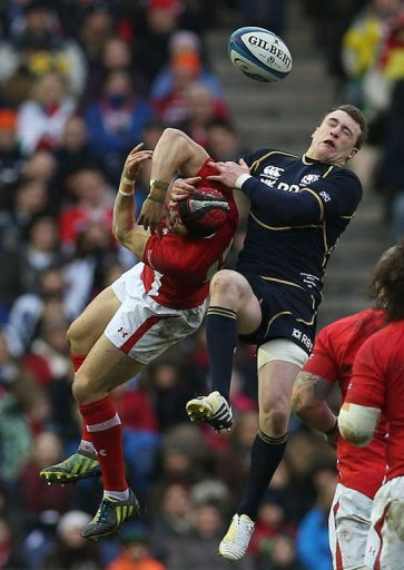 Scotland's Stuart Hogg (right) challenges Leigh Halfpenny during their Six Nations match in Edinburgh on March 9, 2013.