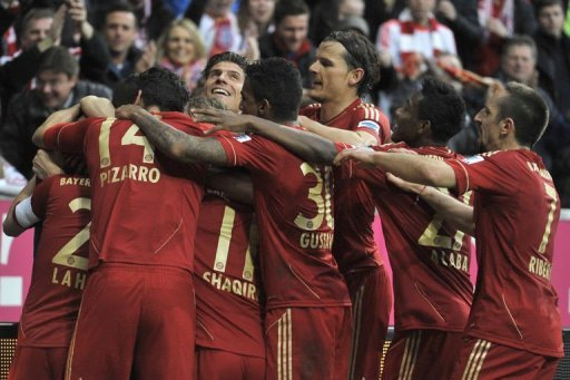 Bayern Munich player celebrate their win against Fortuna in Munich on March 9, 2013