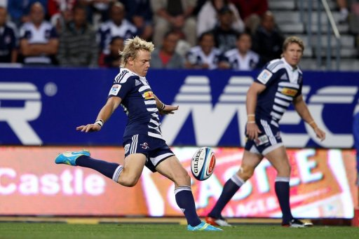 Stormers' Joe Pietersen (L) clears the ball during a Super 15 Rugby match in Cape Town on March 16, 2012