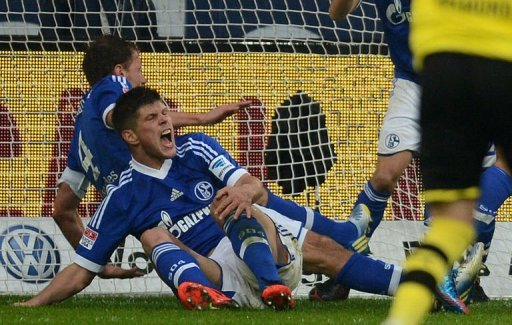 Schalke's Klaas-Jan Huntelaar holds his knee after going down on March 9, 2013