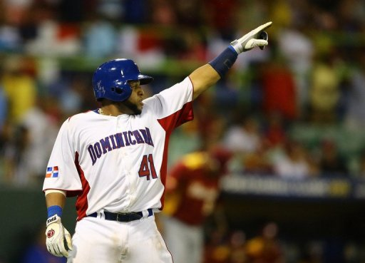 Carlos Santana of the Dominican Republic celebrates after scoring during the World Baseball Classic on March 7, 2013