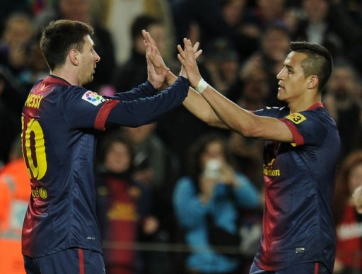 Barcelona's forward Lionel Messi (L) celebrates with forward Alexis Sanchez after scoring in Barcelona, March 9, 2013