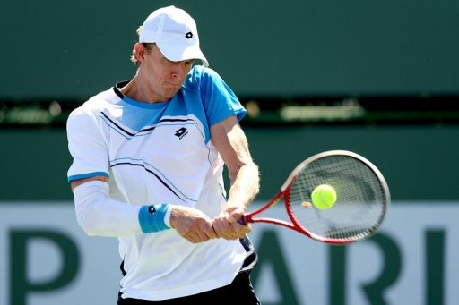 Kevin Anderson of South Africa returns a shot to David Ferrer of Spain on March 9, 2013 in Indian Wells, California