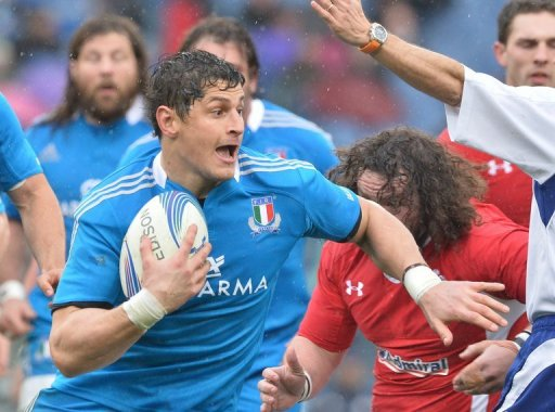 Italy's Edoardo Gori runs with ball during their Six Nations match against Wales, in Rome, on February 23, 2013