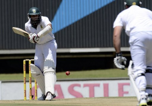 South Africa's Hashim Amla (L) plays a shot during a Test match against Pakistan, in Centurion, on February 22, 2013