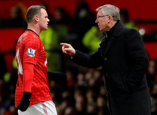 Alex Ferguson (R) gives instructions to Wayne Rooney during the clash with Southampton on January 30, 2013