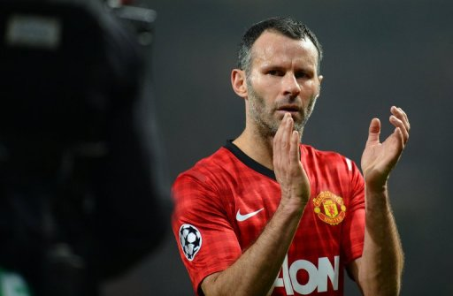 Manchester United midfielder Ryan Giggs applauds at the end of the defeat to Real Madrid on March 5, 2013