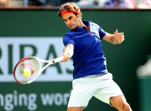 Roger Federer returns to Denis Istomin at Indian Wells on March 9, 2013