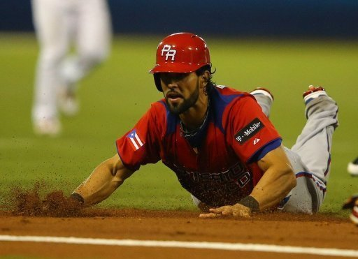 Angel Pagan of Puerto Rico is out after being tagged in a run down against Venezuela on March 9, 2013