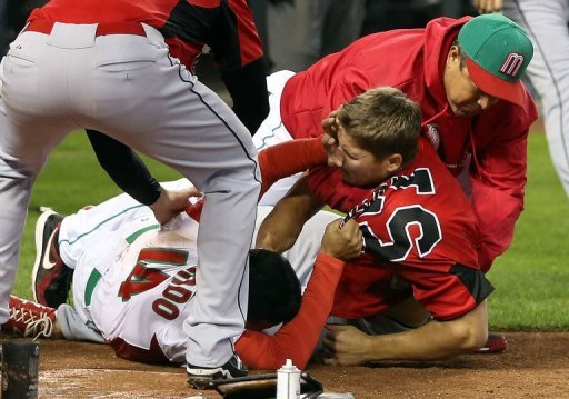 Eduardo Arredondo (L) of Mexico fights with Jay Johnson of Canada during the World Baseball Classic on March 9, 2013
