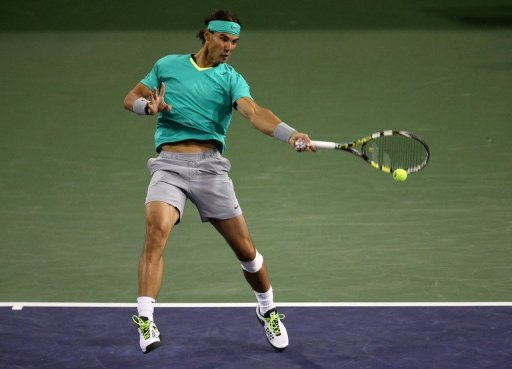 Rafael Nadal hits a return to Ryan Harrison at the BNP Paribas Open at Indian Wells on March 9, 2013