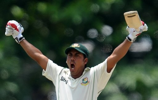 Bangladesh's Mohammad Ashraful raises his bat in celebration after scoring a century against Sri Lanka in Galle on March 10, 2013. Ashraful and Mushfiqur Rahim smashed impressive centuries in a record stand as Bangladesh dominated the third day.