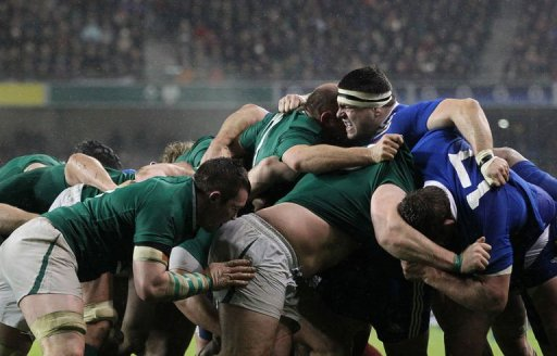 France's Guilhem Guirado grimaces during a scrum during their match against Ireland in Dublin on March 9, 2013