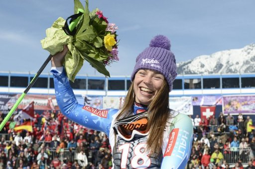 Tina Maze celebrates after winning the FIS World Cup Women's Downhill in Garmisch-Partenkirchen, on March 2, 2013