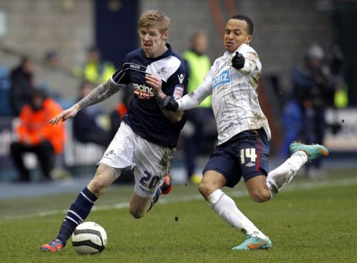 Millwall's Andrew Keogh (L) vies with Blackburn Rover's Marcus Olsson at The Den in South London on March 10, 2013