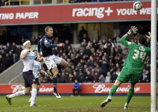 Millwall's Rob Hulse (C) shoots over the crossbar at The Den in South London on March 10, 2013