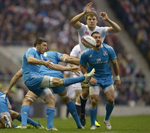 Italy's scrum half Edoardo Gori kicks the ball clear at Twickenham on March 10, 2013