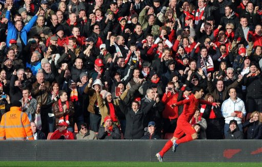 Liverpool's Luis Suarez celebrates scoring in Liverpool on March 10, 2013