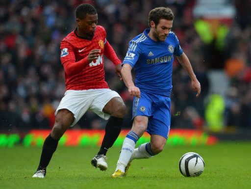 Manchester United's Patrice Evra (L) vies with Chelsea's Juan Mata at Old Trafford, on March 10, 2013