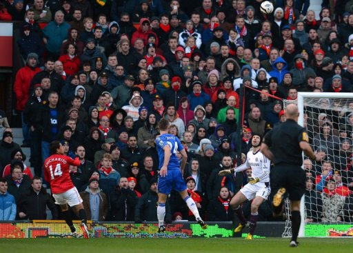 Manchester United's Javier Hernandez (L) scores the first goal at Old Trafford on March 10, 2013