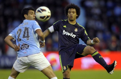 Celta's Augusto Fernandez (L) vies with Real Madrid's Marcelo in Vigo, on March 10, 2013