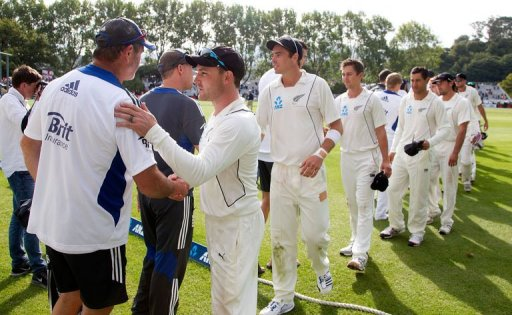 New Zealand's Brendon McCullum (R) shakes hands with England's batting coach Graham Gooch in Dunedin on March 10, 2013