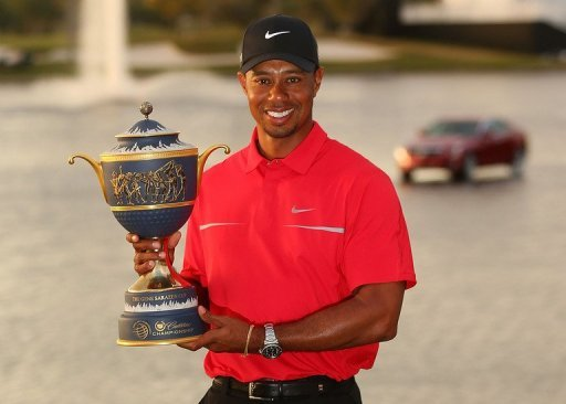 Tiger Woods poses with the Gene Sarazen Cup on March 10, 2013 in Doral