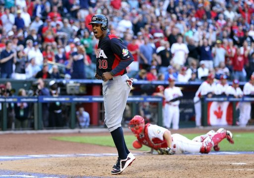 Adam Jones of the USA celebrates after scoring a run against Canada the World Baseball Classic on March 10, 2013