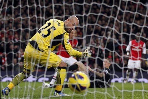 Liverpool goalkeeper Pepe Reina (L) is pictured during a Premier League match against Arsenal on January 30, 2013
