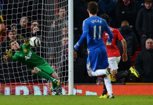 Man United goalkeeper David de Gea (L) makes a late save during their FA Cup match against Chelsea on March 10, 2013