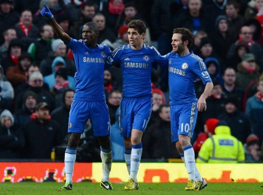 Chelsea's Ramires (L) celebrates with teammates Oscar (C) and Juan Mata during their match on March 10, 2013