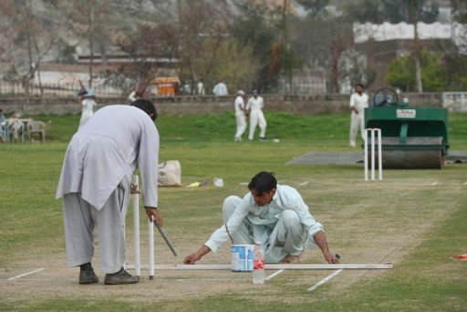 Ground staff prepare a pitch in northwest Swabi, the hometown of a Pakistani cricketer Fawad Ahmed on March 9, 2013