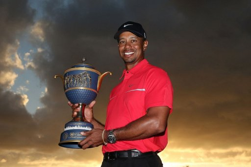 Tiger Woods poses with the Gene Sarazen Cup at the Trump Doral Golf Resort & Spa on March 10, 2013 in Doral