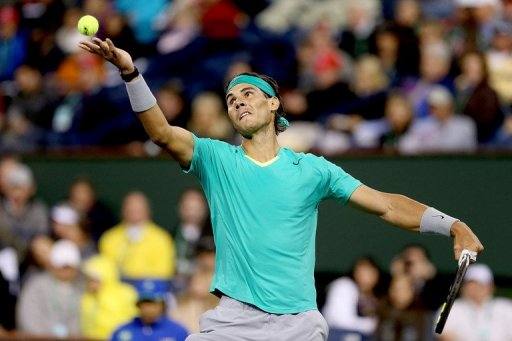 Rafael Nadal serves during the BNP Paribas Open at the Indian Wells Tennis Garden on March 9, 2013 in Indian Wells