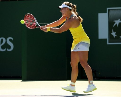 Angelique Kerber of Germany hits a return to Yanina Wickmayer of Belgium on March 11, 2013 in Indian Wells, California