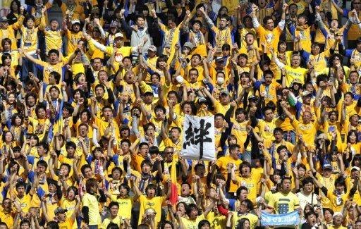 Supporters of Vegalta Sendai cheer at Yurtec Stadium in Sendai, Miyagi prefecture on April 29, 2011